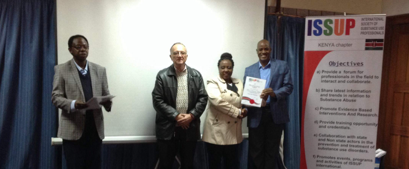 Mr. Oloo (President), Dr William Sinkele and Dr Dr. Beatrice Kathungu issuing membership certificate.
